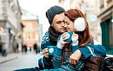 Young couple with coffee in winter outside